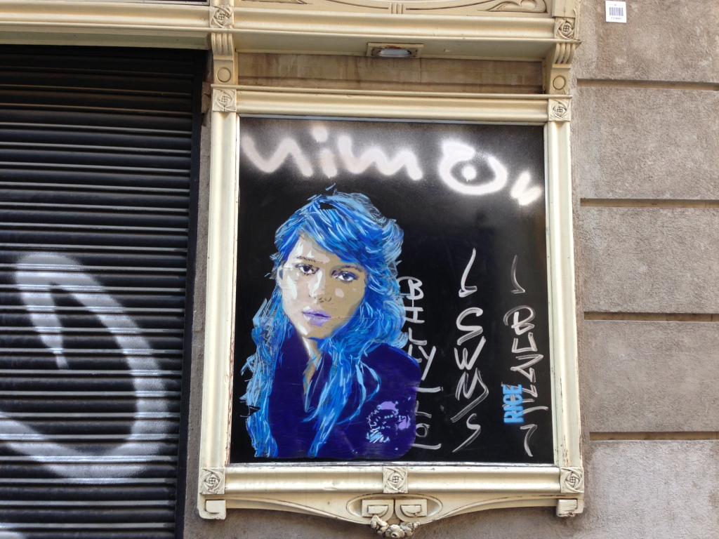 blue haired woman by Barcelona street art Rice